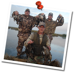 Happy duck hunters with a full bag limit of ducks from Delacroix Louisiana